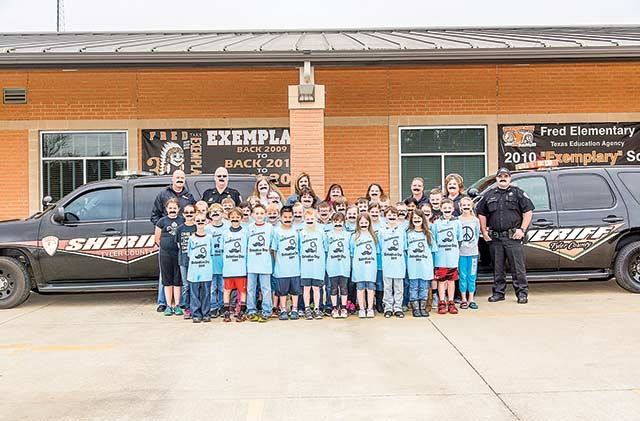 Fred Elementary third graders don mustaches to celebrate Detective Day. (Hale Hughes Photo)