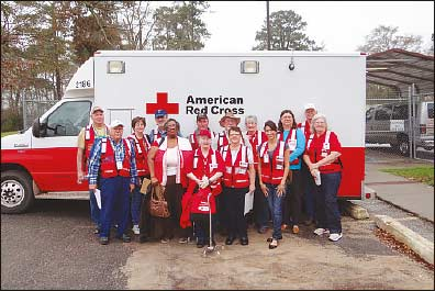 In front of the Red Cross Emergency Response van, donated by the people of Kuwait and Red Crescent Society, front L-R are John Stagg, Wanda Copes-Simmons, Mary Annette Stagg, Dickie Russell Henderson, Natalie Prosperie and Linda Slagle. Back row L-R are Leslie Smith, Tina Richards, James Richards, Travis Smith, David Henderson, Sharon Smith, Joanna Richmond and Dale Slagle.