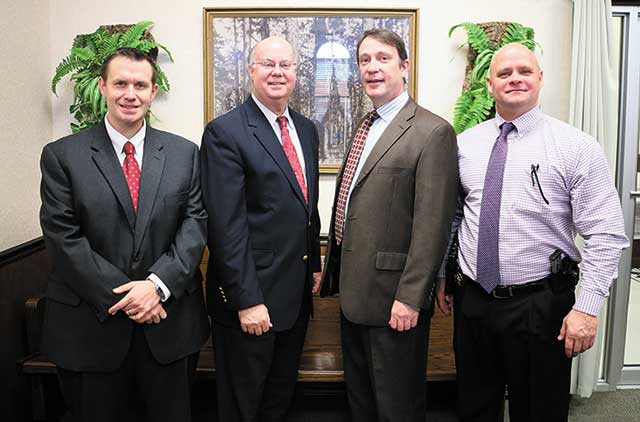 Tyler County commissioners welcomed Dallas Barrington, the newest full time attorney for the county, during Commissioners Court Monday.  Pictured L-R: Barrington, Judge Jacque Blanchette, Assistant District Attorney Eric Hillman and Sheriff Bryan Weatherford. (Kelli Barnes/Tyler County Booster Photo)