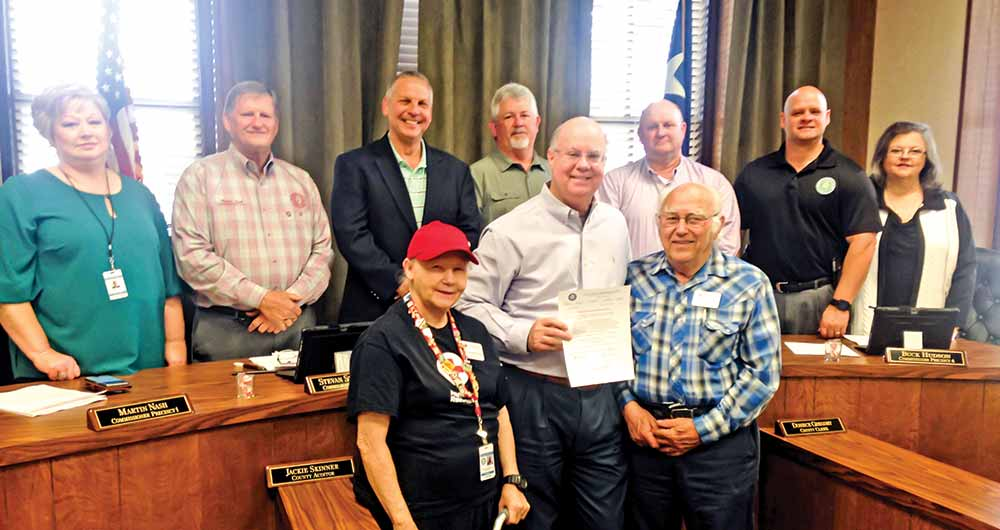 County Judge Jacques Blanchette (center) presents a proclamation of March as Red Cross Month in Tyler County, along with commissioners and other elected officials. Annette and John Stagg from the Red Cross were on hand to represent the organization. (CHRIS EDWARDS | TCB PHOTO)