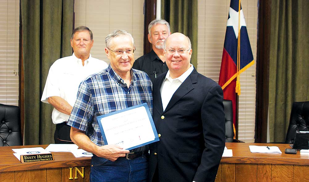 Tyler County Historical Commission President Bob Morris receives a Distinguished Service Award from the Texas Historical Commission at last week's meeting of the Tyler County Commissioners Court. County Judge Jacques Blanchette and commissioners Martin Nash and Jack Walston are pictured with Morris. (CHRIS EDWARDS | TCB)