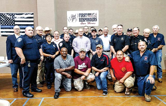 Tyler County's First Responders were honored with a banquet hosted by the Woodville United Methodist Church Men's Breakfast Group Saturday evening, May 29, in the WUMC's Wesley Center.  Pictured are most of the first responders who came, though several had to return to duty before the photo was taken.
