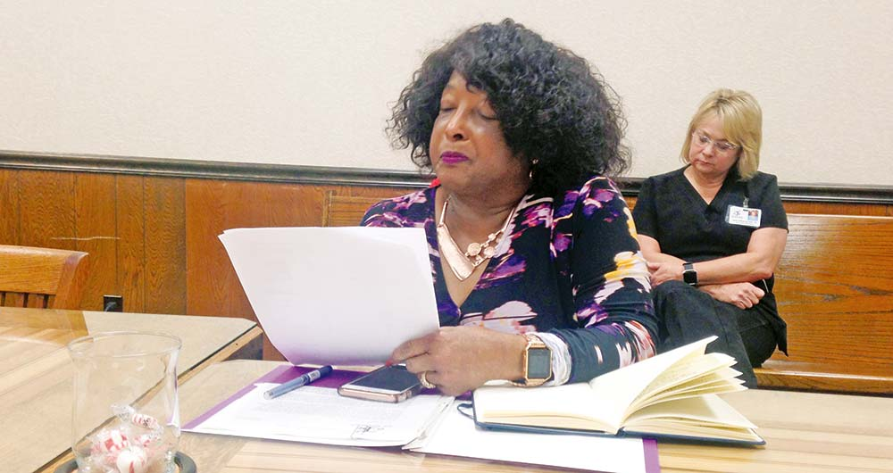 Tyler County Hospital CEO Dr. Sandra Gayle Wright reads from a letter she addressed to Tyler County residents to justify a tax increase proposal for the hospital. (CHRIS EDWARDS | TCB)