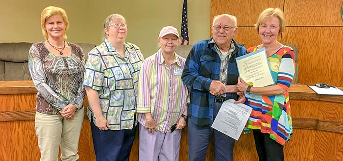 Tyler County Red Cross volunteers Jodi King, Mary Annette Stagg, and John Stagg accepting a proclamation from Woodville Mayor Pro Tem Joyce Wilson after the Woodville City Council proclaimed March Red Cross month in the city.  (Valerie Reddell)