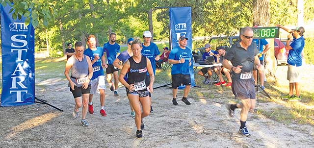 OFF TO THE RACES – Runners get ready to tackle the 10K run on Saturday at Lake Tejas during the Alicyn Mitcham Memorial 5K and 10K Run/Walk event. (ROBERT JACOBUS | TCB)