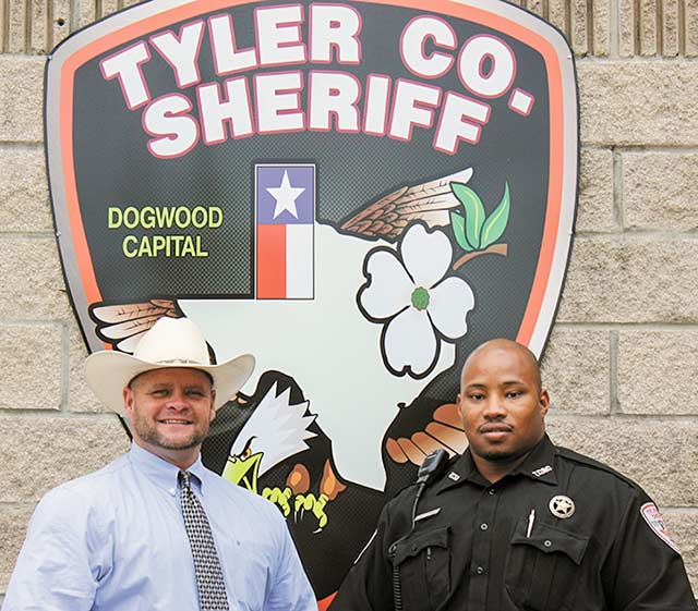 Tyler County Sheriff Bryan Weatherford (left) welcomes new deputy Tawun Mitchell.