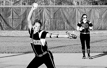 Kacy Priddy pitches in the ball.