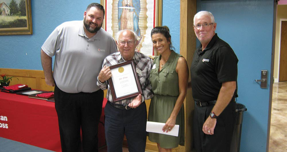 John Stagg received a prestigious life-time achievement award for 10,000 volunteer hours from the Red Cross on Thursday evening, June 20, at St. Michael's Catholic Church in Jasper. Pictured are (L-R) Red Cross Regional Volunteer Service Manager Jake Peters, Stagg, Southeast Texas Chapter Disaster Program Manager Natalie Warren and Chapter Executive Director Chester Jourdan.