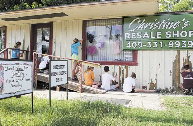Young people paint resale shop