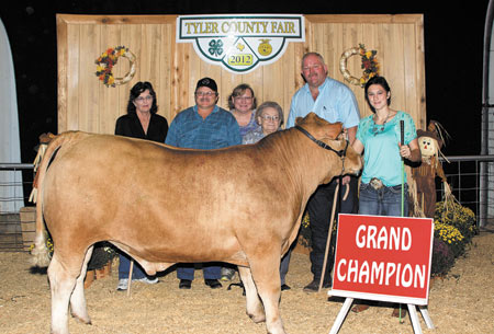 Grand Champion Steer—Lauren Foster from Warren FFA raised the Grand Champion Steer for this Year's Tyler County Fair. The steer brought $8,500 at the auction Saturday night. Buyers were Read Logging, Mrs. R.A. Jernigan, Jackie Young and Catherine Jernigan. (Jim Powers Photo)