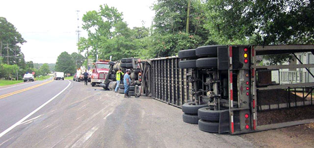 Chip truck overturns on Pine St in Woodville