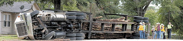 Log Truck driver uninjured in Woodville rollover