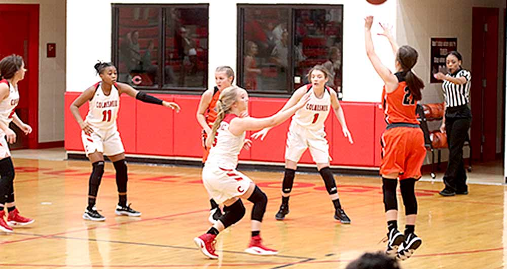 "Aly Gray works some defensive magic for the Lady Warriors"" (PHOTO COURTESY OF WARREN ISD YEARBOOK STAFF)"