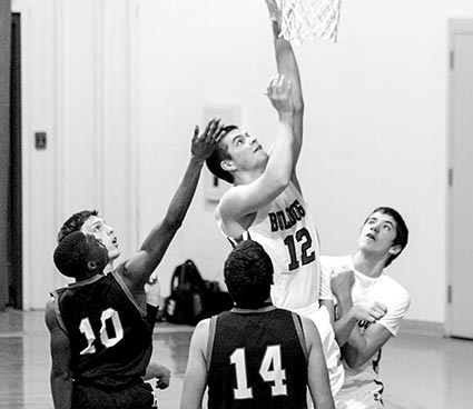Cole Lowery muscles in two of his team high 20 points on the night versus Hull-Daisetta. (Colmesneil Yearbook Staff photo)