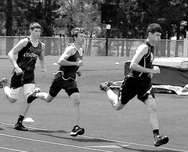 Robby Clark runs hard at the track meet. (Kelsey Sheffield photo)