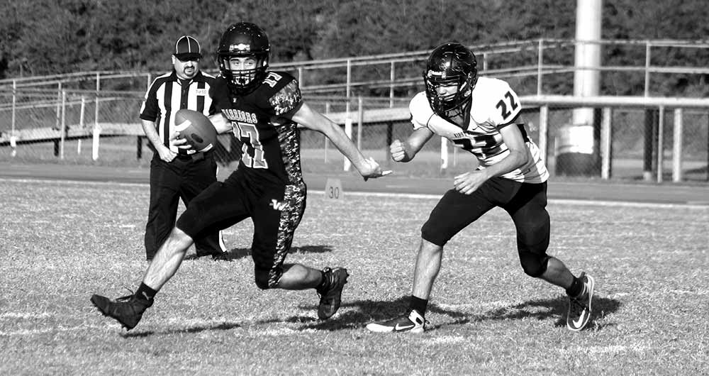 Jeremy Smith runs the ball for the Warriors' JV squad versus Kirbyville. (PHOTO COURTESY OF CARRIE STANDLEY )