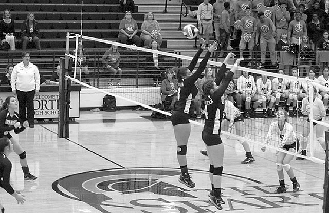 Bailey Hamilton and Claire McEachern go for the block against Brazos.