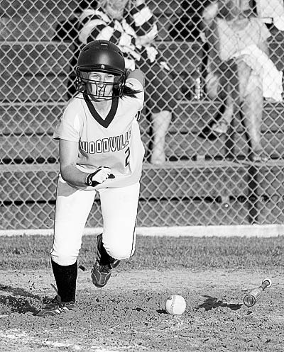 Katie Watts puts down a well placed bunt.